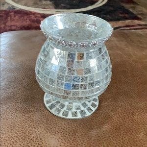 Crystal candle holder with decorate top.